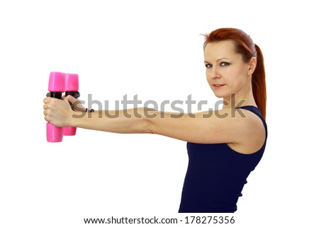 Sport woman with pink barbells in hands doing fitness exercises. Side view portrait isolated on white background