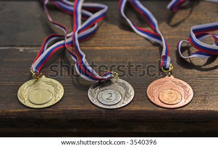 Sporting medals situated on the table - stock photo