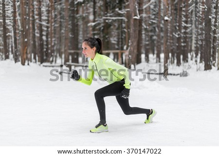 Sportive athlete woman sprinter ready to run waiting for the start running position fitness, sport, training - stock photo