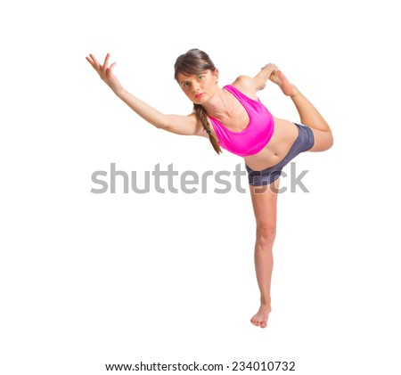 Sportive energy girl standing in an equilibrium position