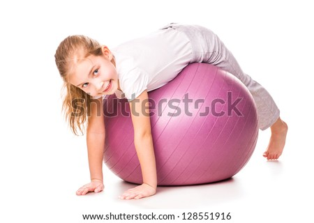 Sportive girl on a fit ball jumping isolated on white