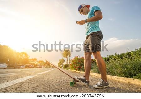 Sportive man at sunset - stock photo