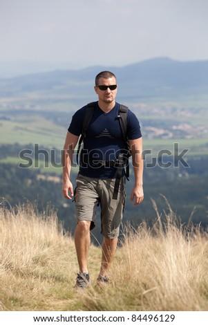 sportive man on the mountain trek - stock photo