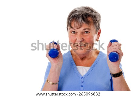 Sportive senior woman exercising with dumbbells - stock photo