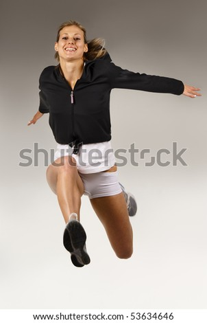 Sportive slim girl jumping up - stock photo