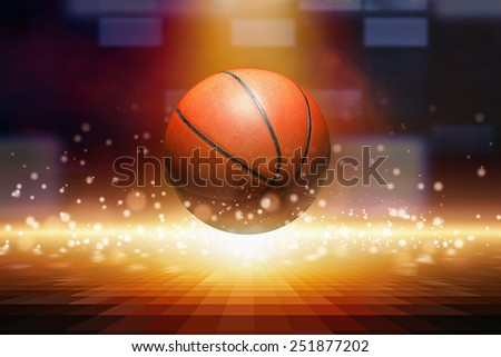 Sports background - basketball, bright spotlight from above, yellow glowing lights - stock photo
