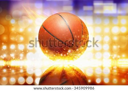Sports background - burning basketball, orange glowing lights with reflection - stock photo
