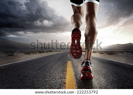 Sports background. Runner feet running on road closeup on shoe.  - stock photo