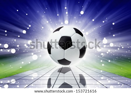 Sports background - soccer ball with reflection, bright spotlights