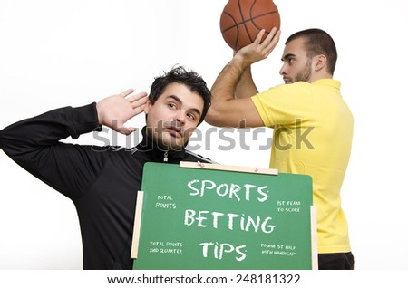Sports betting tips, a guy holding a blackboard eavesdropping, basketball player holding a ball in background, isolated on white - stock photo