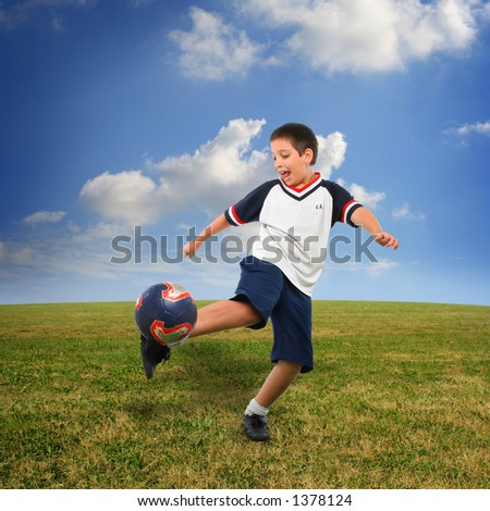 Sports. Boy playing soccer (ball on air). From my football series - stock photo