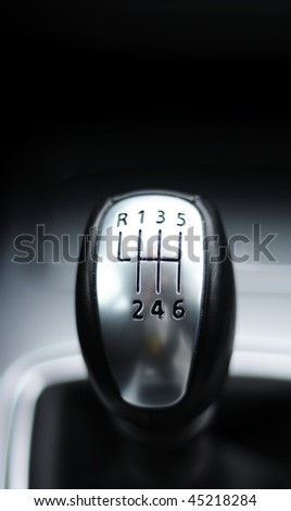 sports car gear shift stick with copyspace for text message - stock photo