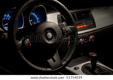 Sports car interior with dramatic night time lighting - stock photo