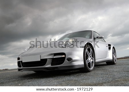 Sports car under storm clouds