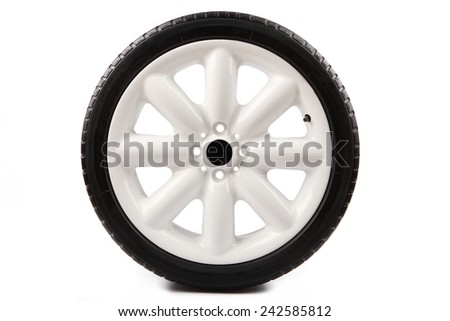 sports car white alloy wheel on white background  - stock photo