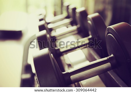 Sports dumbbells in modern sports club. - stock photo