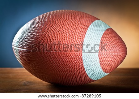 sports equipment. Rugby ball on wood. - stock photo