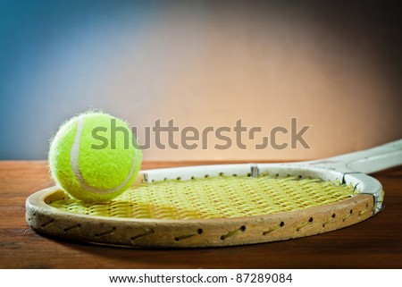 sports equipment. Tennis and racquet on wood. - stock photo