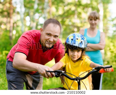 sports family having fun in the forest - stock photo