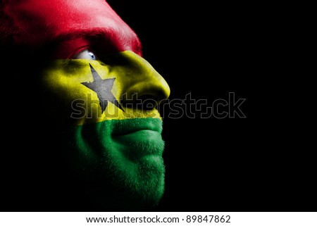 Sports fan - a patriot. On the painted colors of the flag of his country on his face. - stock photo