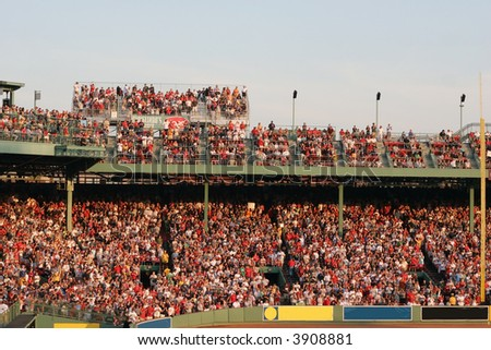 sports fans at red sox baseball game, fenway park - stock photo