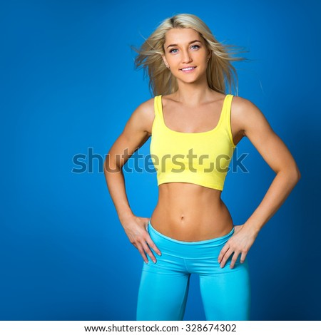 Sports girl on a blue background