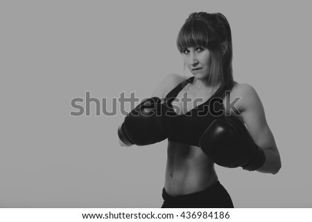 Sports girl with boxing gloves