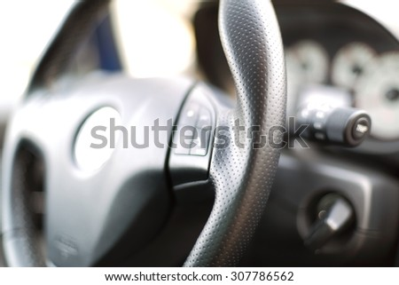 Sports leather steering wheel in a modern car
