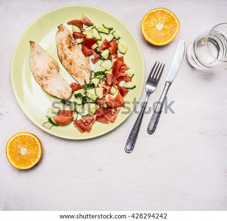 sports lunch, turkey breast with fresh salad, dessert of oranges  place for text top view