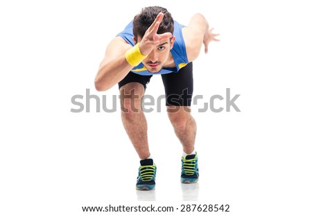 Sports man getting ready to run isolated on a white background - stock photo