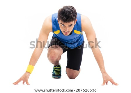 Sports man getting ready to run isolated on a white background. Looking at camera - stock photo