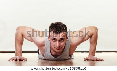 Sports man making pushups,. Care about health and body