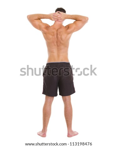 Sports man showing muscular body. Rear view - stock photo