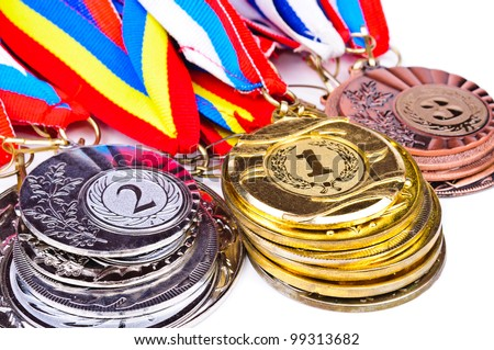 Sports medal in the stacks. Photo Closeup - stock photo