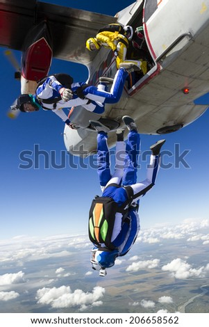 Sports parachutist build a figure in free fall. - stock photo