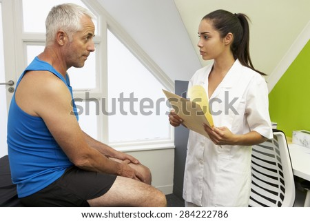 Sports Physiotherapist Treating Male Client