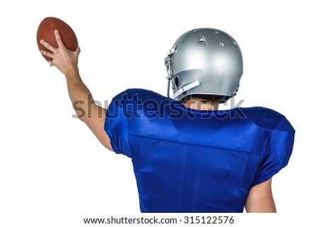 Sports player holding ball against white background