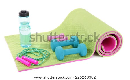 Sports requisites on sport mat isolated on white - stock photo