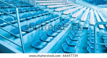 sports stadium with empty seats row - stock photo