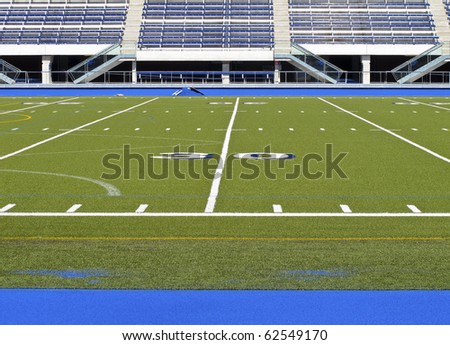 Sports stadium with football field and track - stock photo