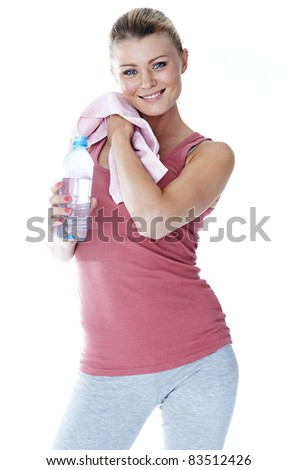 Sports time. Girl in the sports form with a bottle of water and a towel. - stock photo