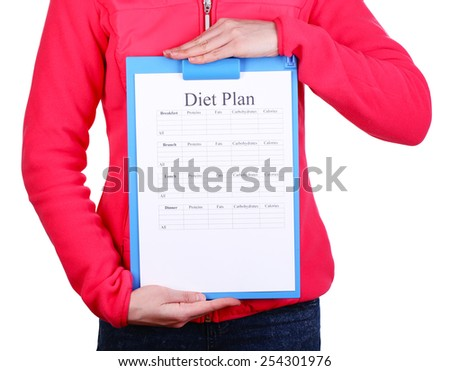 Sports trainer with diet plan isolated on white - stock photo