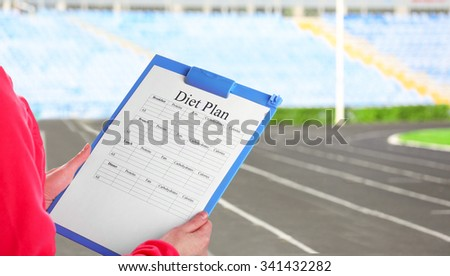 Sports trainer with personal workout plan - stock photo