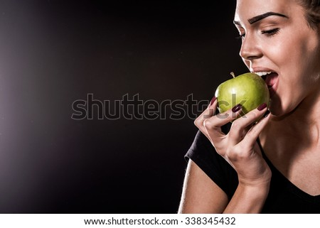Sports Woman Eating Apple - stock photo
