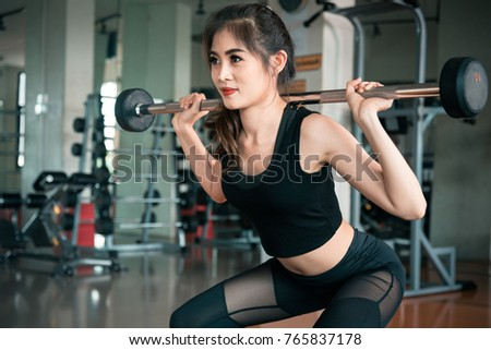 Sports Woman Lifting Weight In Fitness Gym Workout Exercise And Body Build Up Concept