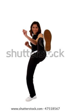 Sports Woman training a high kick - stock photo