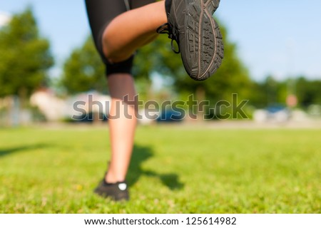 sports - young woman jogging for fitness on a beautiful summer day - stock photo