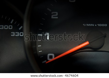 Sportscar dashboard closeup with speedometer