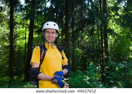 Sportsman at summer park. - stock photo