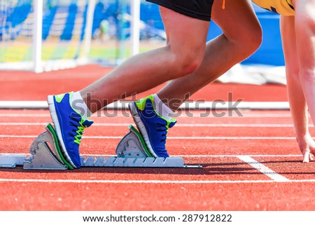 sportsman at the start, sports background - stock photo